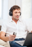 Man with headphones listening to music Royalty Free Stock Images