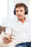 Man with headphones listening to music Royalty Free Stock Photos