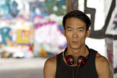 Man with headphones looking toward the camera Stock Photo