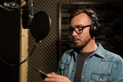 Man with headphones at music recording studio Royalty Free Stock Photography