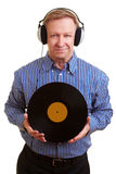 Man with headphones and old record Stock Image