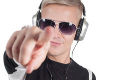 Man with headphones pointing her finger Stock Photography