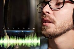 Man with headphones singing at recording studio Royalty Free Stock Photos