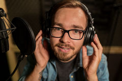 Man with headphones singing at recording studio Royalty Free Stock Photography