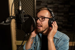 Man with headphones singing at recording studio Royalty Free Stock Photo