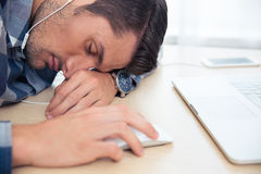 Man with headphones sleeping Stock Photo