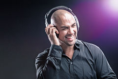 Man with headphones. Smiling black background Stock Photography