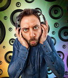 Man with headphones on speakers background Stock Photography