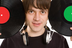 The man with a headphones and vinylic disc. Royalty Free Stock Images