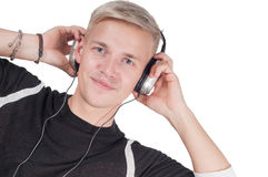 Man in headphones watching on you Stock Images