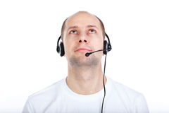 Man with headset. Young adult bald man with headset with a boom microphone royalty free stock photos