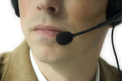 Man with headset. Closeup of lower face and headset stock image
