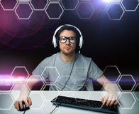 Man in headset computer over hexagons projection Stock Images