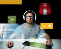 Man in headset computer over virtual media screens Stock Photo