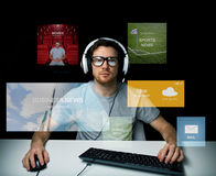 Man in headset computer over virtual media screens Stock Images
