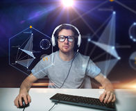 Man in headset with computer virtual projections Stock Photos