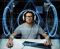 Man in headset with computer virtual projections Stock Image