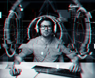 Man in headset with computer virtual projections Royalty Free Stock Image