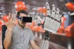 Man with headset is controlling robotic arm with his hand. 3D rendered illustration of robotic hand.  royalty free stock photo