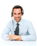 Man with headset leaning on his desk Stock Image
