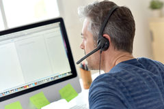 Man with headset in office Royalty Free Stock Photo