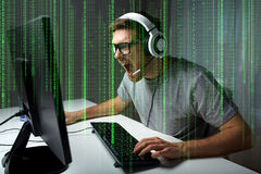 Man in headset playing computer video game at home Stock Photography