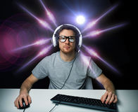 Man in headset playing computer video game Royalty Free Stock Images