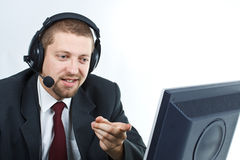 Man with headset showing monitor Royalty Free Stock Image