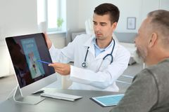 Man with health problem visiting urologist. At hospital royalty free stock photo