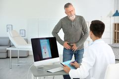 Man with health problem visiting urologist. At hospital royalty free stock photos