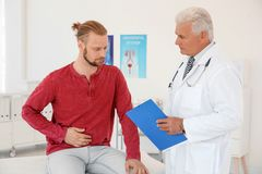 Man with health problems visiting urologist. At hospital royalty free stock photography