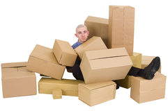 The man is heap up by boxes Stock Image
