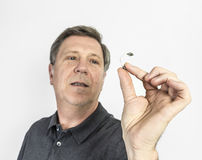 Man with hearing aid. Behind the ear stock photography