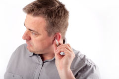 Man with hearing aid Royalty Free Stock Photo