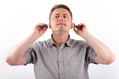 Man with hearing aids. Middle-aged man setting his hearing aids Royalty Free Stock Photography