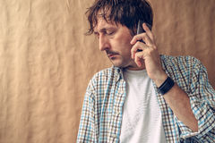 Man hearing bad news on the phone Royalty Free Stock Image