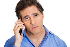 Man hearing a bad news on phone Stock Images