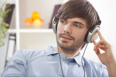 Man hearing music at home Stock Photo