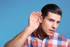 Man with hearing problem royalty free stock image