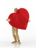 Man With Heart. Wooden model holds a red satin heart on white background Royalty Free Stock Photo