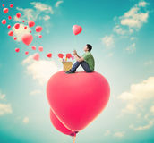Man With Heart Balloons Royalty Free Stock Photos