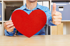 Man with heart holding thumbs up Royalty Free Stock Image