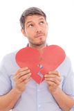 Man heart lover. Man holding broken heart thinking while putting together Royalty Free Stock Photo