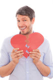 Man heart lover. Man holding broken heart smiling while putting together Royalty Free Stock Photos