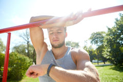 Man with heart-rate watch exercising outdoors Royalty Free Stock Images