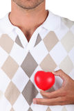 Man with heart-shaped box Stock Photography