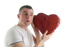 Man with a heart shaped box Stock Images