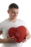 Man with a heart shaped box Royalty Free Stock Photos