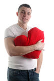 Man with a heart shaped pillow Royalty Free Stock Photos