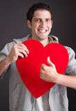 Man with heart thumbs up Royalty Free Stock Photos